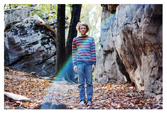 rainbow above you (Mary Jo.) Tags: autumn boy portrait fall smile leaves canon happy rebel 50mm sweater rainbow mj aaron jeans boulders flare manual xs f18 maryjo striped mossrock