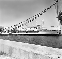 Calypso, the old mine sweeper belonging to Jacques Cousteau is seen at Bayboro Harbor in Saint Petersburg, Florida, 1974 (alcomike43) Tags: old blackandwhite bw classic water port vintage harbor photo ship vessel historic negative photograph calypso saltwater minesweeper jacquescousteau royalnavy saintpetersburgflorida bayboroharbor j826