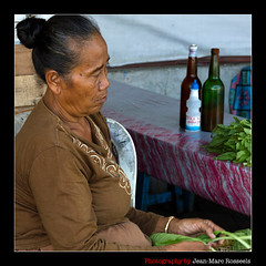 At Work (jean-marc rosseels) Tags: street woman color colors vegetables lady canon indonesia java candid streetportrait streetlife streetscene vegetable yogyakarta seller candidportrait streetcapture canon7d jeanmarcrosseels