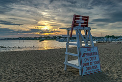 On the lookout for a good sunset (tquist24) Tags: clinton clintontownbeach connecticut hdr lifeguard longislandsound nikon nikond5300 outdoor beach boat boats chair clouds evening geotagged harbor ocean reflection reflections sand sky sunset water unitedstates