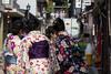 Maikos busy taking selfie (HansPermana) Tags: kyoto japan traditional dress kimono geiko geisha maiko gion sunny spring street girls people busy crowds dressingup costume colorful