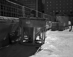 Concrete Bucket (geowelch) Tags: downtowneast toronto urbanfragments urbanlandscape constructionsite shadows metal blackwhite film 120 mediumformat txp320 trix fujigs645s plustekopticfilm7400 645 6x45 hc110