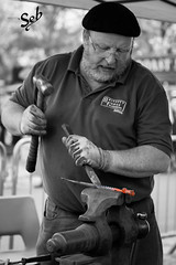 Blacksmith at work (Photography by Seb) Tags: bw blacksmith metalworking manatwork craftsman
