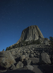 Devil's Tower, Wyoming, USA under night sky (Cat Girl 007) Tags: adventure america attraction butte craggy devilstower dramatic environment freedom geology hillside iconic isolation laccolith landmark landscape longexposure monolith monument nationalmonument nationalpark nature nightphotography nightsky outdoors outside park religious rock rockformations rugged rural sacred scenic sedimentaryrock sightseeing solitude starfield starry stars stones tourism tower travel traveldestination trees usa verticalimage wyoming