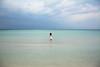 In mare - In the sea. (sinetempore) Tags: mare sea ionio salento torrelapillo nuvole clouds ragazza girl battigia blu blue marecalmo cristallino inmare inthesea