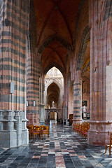 Interior (chrisdingsdale) Tags: arch arc altar ancient architecture art bench belgium belgian building chair cross confessional confession curve chandelier column ceiling church cathedral christianity catholic catholicism europe floor fretwork glass gothic gallery historic interior light loggia lamp medieval old passage religion religious sthubert sunlight stainedglass vault vaulted window worship