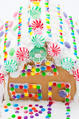 high angle view of a gingerbread cake (capsfood8877) Tags: christmas food house cake photography design pattern sweet nobody nopeople indoors whitebackground christmasdecoration studioshot gingerbreadhouse ornate foodanddrink anthropomorphic patterned colorimage gingerbreadcookie highangleview sweetfood