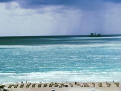 Beach view from the Delano (Dan_DC) Tags: ocean travel beach squall chairs florida miami stock scenic atlantic license miamibeach luxury southbeach rf delano fon imagebank worldtravel delanohotel royaltyfree luxurytravel travelinginstyle flatfee travelingfirstclass premiumtravel