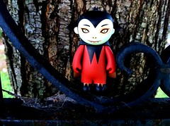 Little Vampire (welovethedark) Tags: tree halloween vampire spiderweb iphone taramcpherson oldwroughtironfence vampireboy iphonecamera photoshopforiphone iphonecameraapps