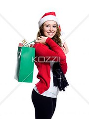 portrait of a smiling young female carrying shopping bags (people12mickah) Tags: christmas winter vacation portrait woman holiday beautiful beauty smiling fashion festival retail female scarf festive season photography holding pretty december gorgeous style happiness celebration indoors event whitebackground portraiture trendy attractive surprise studioshot bags sideview youngadult santahat curlyhair occasion shopaholic consumerism preparation adultsonly religiouscelebration oneperson preparing carrying traditionalculture buying winterwear caucasian headwear individuality headgear shoppingbags toothysmile colorimage onewomanonly lookingatcamera winterclothing oneyoungwomanonly threequarterlength attractivefemale expressingpositivity 2024years publiccelebratoryevents