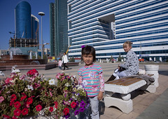 Little Girl And Flowers, Astana, Kazakhstan (Eric Lafforgue) Tags: kazakhstan kazakh centralasia easterneurope astana capitale capital horizontal kz5777 humanbeing etrehumain personne person people enpied photoenpied fulllength dehors outdoors outside exterior exterieur vueexterieure sourire smile joie bonheur hapiness joy naivete innocence childhood enfance jeunesse youth akmolinsk akmola female fillette fille girl femme woman banc bench fleurs flowers place square edifice structure batiment building architecture positionassise sittingposition contemplation regardantlacamera lookingcamera lookingatcamera jetdeau fountain fontaine plaza sitting assise noursoultan
