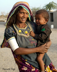 Woman with her Child in Thar Desert (Tanwir Jogi) Tags: travel pakistan colour beautiful trekking trek women colours child dress desert fort traditional printing cannon block traveling cloth tours handicrafts making sind lahore thar treks mehran jogi g9 ajrak beautifulpakistan trekkinginpakistan hinduwomen nagarparkar naukot smallindustries coloursofpakistan cannong9 tanwir travelinginpakistan thariwomen thetrekkerz tourisminpakistan tanwirjogi craftsofpakistan thariwoman