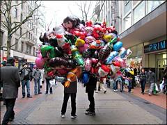 Take Your Pick (pefkosmad) Tags: uk england people balloons birmingham balloon streetscene vendor seller birminghamchristmasmarket