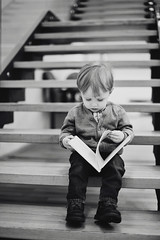 in the library (ramung) Tags: boy canon 50mm reading book blackwhite kid toddler child library interest