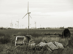 beach chair idyll (Soenke HH) Tags: winter bw monochrome field composition germany deutschland photography energy bokeh absurd north norden felder olympus forgotten schwarzweiss windrad strandkorb tristesse holstein e5 windturbines paletten beachchair vergessen scharzweiss blackwhitephotos energiewende swd1260