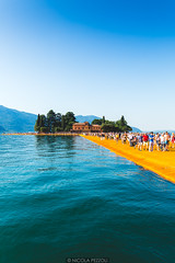 Island connexion (Nicola Pezzoli) Tags: blue sky people italy lake tourism nature water colors yellow canon reflections island san paolo piers floating bergamo brescia lombardia iseo