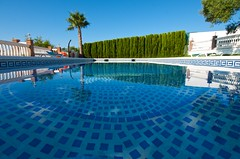 #56/100 - Serenity (Rum Bucolic Ape) Tags: pool ultrawide spain tokina1120 serene serenity relaxing relaxation creativity creative nerja andalusia swimmingpool blue tile reflections
