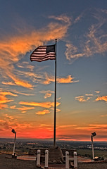 Freezeout Hill Memorial (http://fineartamerica.com/profiles/robert-bales.ht) Tags: gemcounty haybales idaho misc people photo places scenic states sunrisesunset sunrise sunsetemmett flag memorial moonument freezeout hill unitedstates america stripes blueandwhite stars sunset yellow red pole silhouette freedom democracy betsyross beautiful sensational spectacular awesome magnificent peaceful surreal sublime magical spiritual inspiring inspirational colorful canonshooter wow usa robertbales