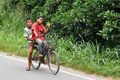 Sibolga - Right On !! Whateva Dude !! (Drriss & Marrionn) Tags: travel sibolga sumatra indonesia outdoor people kid kids child children bike sign greeting