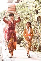 Sunday Best (killerturnip) Tags: travel sunset bali woman girl walking indonesia asian costume asia traditional exotic offering backlit ubud balinese