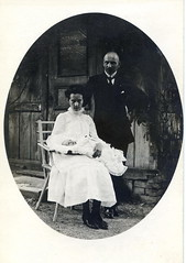 Solemn young mother, smiling father... (elinor04) Tags: family portrait woman baby man vintage found outdoors photo hungary shot father mother photograph 1900 1900s swaddle rppc rzsahegy