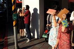 (AntEater Theater) Tags: sunset sun eyes waiting shadows bright taiwan streetphotography sunny repetition taipei purses blocking wallets shading