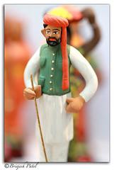 Navaratri Bombe (Wooden Dolls) (briejeshpatel) Tags: india festival canon dolls paintings culture diwali canondslr mysore deepawali woodendolls dussera navarathridolls canonllens canon7d briejeshpatel canon100mmf28lmacro brijeshpatel navarathribombe