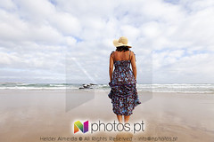 Woman in a desert beach (nphotos.pt) Tags: ocean sea woman beach portugal nature water beautiful hat female fun outside outdoors coast sand women europe pretty loneliness peace dress remote serene concept rearview cheerful relaxed discovery portuguese agi connection connect pleased ashore peniche