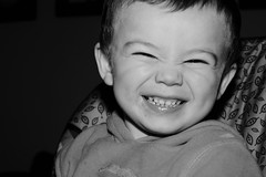 (Skelleton) Tags: b boy portrait blackandwhite food baby white black smile photography child eating candid pudding spoon highchair corny cheesey