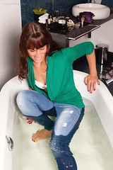 Enjoying a fully clothed bath (Wet and Messy Photography) Tags: woman wet girl shower milk longhair bathtub wethair wetlook wetjeans