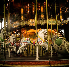 carousel (multiwitamina) Tags: street light horse white paris france color colour 6x6 yellow analog square gold daylight nice colorful europe carousel lubitel medium format 166b