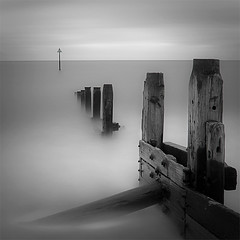 Receding (mono mania) Tags: ocean longexposure sea blackwhite marker groins teignmouth nd110