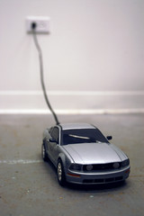 Untitled     Toy car, Cord,     Installation, Video.     38 X 150 X 76 (cm)  15 X 60 X 30 (inch)