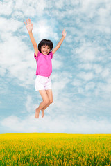Little girl jumping against beautiful sky (Patrick Foto ;)) Tags: park blue sky people cloud white green nature girl beautiful up field grass childhood sport youth asian fun outside happy person freedom fly kid spring high jump child play hand open exercise little outdoor joy young meadow lifestyle happiness competition victory thai environment recreation activity cheerful joyful playful upward caucasian