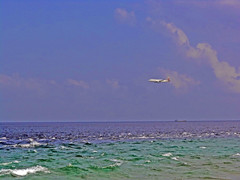 204. The Final Approach (Le Dsir De La Couronne) Tags: ocean blue sea water plane waves afternoon altitude horizon flight airways friday approach maldives qr qatar mal beyondthehorizon