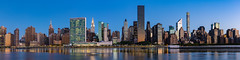 Midtown Manhattan (Amar Raavi) Tags: manhattan midtown panorama midtownmanhattan skyscrapers newyorkcity nyc newyork unitedstates cityscape midtowneast dawn eastriver river water landscape longexposure reflections buildings blue unitednations rooseveltisland ny reflection bluehour outdoor empirestatebuilding chryslerbuilding highresolution