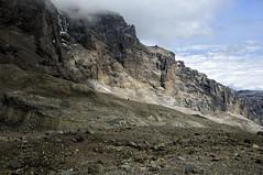 Cliffs near Arrow Glacier Camp - Kilimanjaro National Park - Tanzania (PascalBo) Tags: nikon d300 tanzania tanzanie africa afrique eastafrica afriquedelest kilimanjaro kilimandjaro kilimanjaronationalpark parcnationaldukilimandjaro lemosho hike hiking trek trekking outdoor outdoors volcanic rock stone pascalboegli