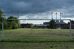 Playing field, goalpost and chimneys in Melksham (Ian Redding) Tags: city england melksham uk wiltshire avontyres chimneys cloudy goalposts industrial landscape playingfield town windy