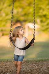 Reese and a Swing (donnierayjones) Tags: toddler kid child girl swing swinging playground park holding hold jeans shorts