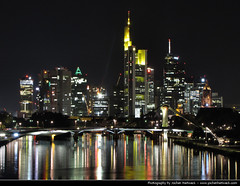 Skyline seen from the Deutschherrnbrcke, Frankfurt (JH_1982) Tags: city bridge urban reflection skyline architecture night river germany deutschland lights evening abend cityscape hessen skyscrapers nacht frankfurt main architektur alemania brcke fluss allemagne spiegelung germania alemanha highrises beleuchtung lichter francfort frankfurter duitsland nachtaufnahme nighshot hesse meno wolkenkratzer   beleuchtet hochhuser francoforte  almanya  deutschherrnbrcke frncfort   c        deutschherrnbrucke