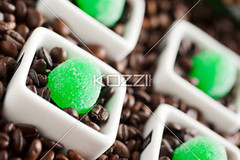 coffee beans and green candies (nonafood8877) Tags: morning food brown black green texture cup coffee closeup breakfast dark circle photography beans close candy drink sweet coffeecup object beverage seed nobody nopeople row fresh roast textures delicious sphere drinks round mug espresso studioshot taste shape caffeine cappuccino aromatic candies beverages grind foodanddrink isolated saucer confectionery textured freshness baked conformity roasted identical aroma refreshment scented inarow blackcoffee colorimage brewed bakedfood darkcoffee nonalcoholicbeverage sweetfood greencandies nonalcoholicdrink