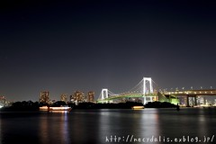 Rainbow bridge... (necydalis) Tags: bridge light sea japan architecture night t japanese tokyo bay boat rainbow nikon ship side distagon carlzeiss 1435 d700 top20bridges ruby5