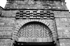 Decorative brickwork over door (Jon-UK) Tags: windows bw white black brick church details adoremus adorer adorar  adhradh addoliad
