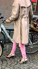Dressed for biking? (ockie50) Tags: leica pink woman lund bike shoes highheels streetphotography trenchcoat summicron 35 tightpants m9 highheeledshoes summicron352asph leicam9 summicronm352asph