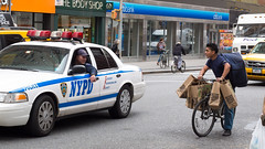 A brief talk (wwward0) Tags: street newyork car cyclist traffic unitedstates broadway police nypd overloaded deliveryman