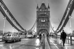 London Tower Bridge - B&W (Laura Lucy Lee) Tags: life street morning bridge winter bw london wet rain traffic january busy rush hour londontowerbridge payments