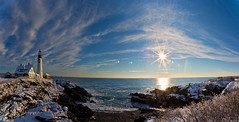 Portland Head Light in Snow Panorama 2--EXPLORED! (Cindy Farr-Weinfeld) Tags: blue winter sky panorama sun lighthouse snow clouds coast daylight lighthouses day maine sunny panoramic coastal capeelizabeth