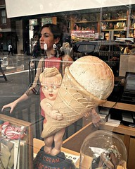 ice cream dream (omoo) Tags: window glass girl vintage reflections 1930s display books streetscene bookstore storewindow windowdisplay streetfair bleeckerstreet icecreamgirl markjacobs salesstaff icecreamdream bookmarc icecreamadvertising west11thandbleeckerstreets boywithlargeicecreamcone vintageicecreamadvertising