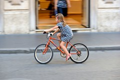 Junior cycle chic (jeremyhughes) Tags: vehicle bike wheel rome viadelcorso child girl bicycle cyclist cycling polkadotted polkadots youth dress sandals peugeot street urban city motion movement serious concentration concentrating hairgrip nikon d750 nikkor 80200mmf28d