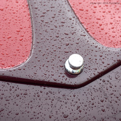 silver knob (Furcletta) Tags: italy ita altoadige suedtirol holidays europe cars car classiccars bozen rain waterdroplets sheetmetal fragment 70180mm4556dmicro red silver chromesteel brown